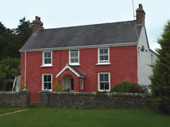 Well proportioned, lime roughcast and traditional limewashed house